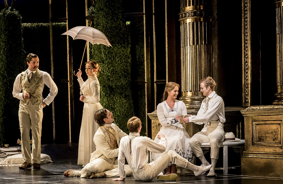 Matthew Bourne's SLEEPING BEAUTY. Ashley Shaw (Aurora) and company. Photo by Johan Persson